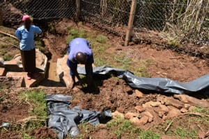 The Water Project: Lukala West Community, Luka Spring -  Back Filling With Polythene