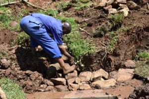 The Water Project: Lukala West Community, Luka Spring -  Back Filling With Stones