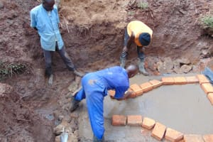 The Water Project: Lukala West Community, Luka Spring -  Brick Setting And Alignment