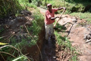 The Water Project: Lukala West Community, Luka Spring -  Digging The Drainage Channel