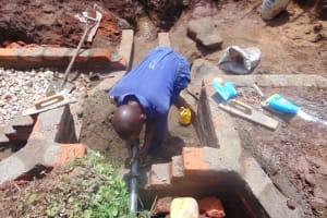 The Water Project: Lukala West Community, Luka Spring -  Pipe Setting