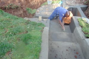 The Water Project: Lukala West Community, Luka Spring -  Plastering The Floors