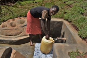 The Water Project: Lukala West Community, Luka Spring -  Fetching Water At The Spring