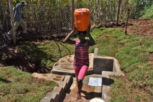 The Water Project: Lukala West Community, Luka Spring -  Leaving With Water From Luka Spring