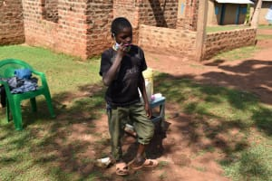The Water Project: Lukala West Community, Luka Spring -  Demonstrating Brushing Teeth