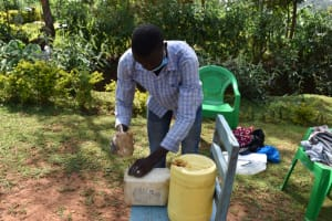 The Water Project: Lukala West Community, Luka Spring -  Demonstrating How To Make A Tippy Tap