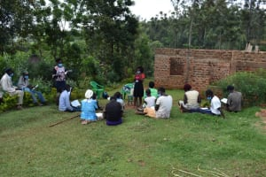 The Water Project: Lukala West Community, Luka Spring -  Group Learning Mask Wearing