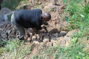 The Water Project: Lukala West Community, Angatia Spring -  Backfilling With Stones