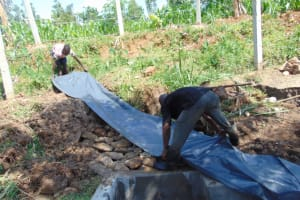 The Water Project: Lukala West Community, Angatia Spring -  Backfilling With Plastic