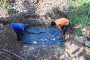 The Water Project: Lukala West Community, Angatia Spring -  Foundation Plastic Sheet