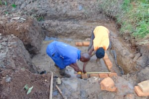 The Water Project: Lukala West Community, Angatia Spring -  Brick Setting