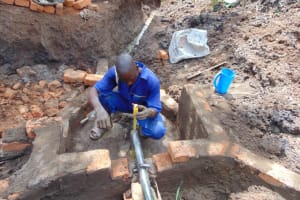The Water Project: Lukala West Community, Angatia Spring -  Pipe Setting