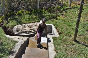 The Water Project: Lukala West Community, Angatia Spring -  Collecting Water