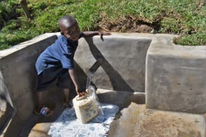 The Water Project: Lukala West Community, Angatia Spring -  Fetching Water From Spring