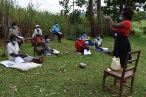 The Water Project: Lukala West Community, Angatia Spring -  Handwashing Demonstration
