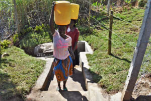 The Water Project: Lukala West Community, Angatia Spring -  Leaving With Clean Water