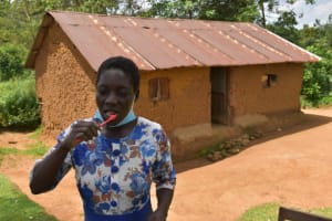 The Water Project: Lukala West Community, Angatia Spring -  Community Member Brushes Teeth