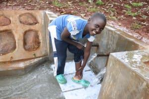 The Water Project: Shikoye Community, Kwa Witinga Spring -  John Cleaning His Feet