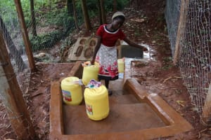The Water Project: Shikoye Community, Kwa Witinga Spring -  Susan With Her Container Of Water