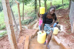 The Water Project: Shikoye Community, Kwa Witinga Spring -  Carrying Containers Home