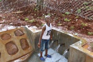 The Water Project: Shikoye Community, Kwa Witinga Spring -  Child Playing With Water