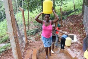 The Water Project: Shikoye Community, Kwa Witinga Spring -  Gathering Water