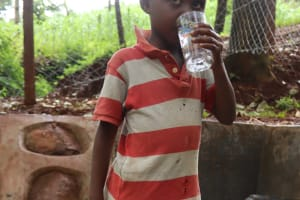 The Water Project: Shikoye Community, Kwa Witinga Spring -  Quenching Thirst From The Spring