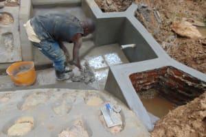 The Water Project: Shisasari Itumbu Community, Mathias Juma Spring -  Plastering The Floor