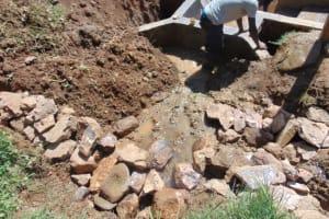 The Water Project: Shisasari Itumbu Community, Mathias Juma Spring -  Backfilling With Clay