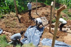 The Water Project: Shisasari Itumbu Community, Mathias Juma Spring -  Backfilling With Plastic Sheet