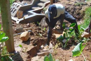 The Water Project: Shisasari Itumbu Community, Mathias Juma Spring -  Backfilling With Stones