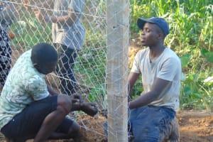 The Water Project: Shisasari Itumbu Community, Mathias Juma Spring -  Fencing With Chainlink