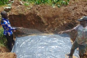 The Water Project: Shisasari Itumbu Community, Mathias Juma Spring -  Foundation With Wire