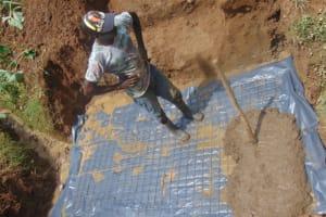 The Water Project: Shisasari Itumbu Community, Mathias Juma Spring -  Laying The Slab
