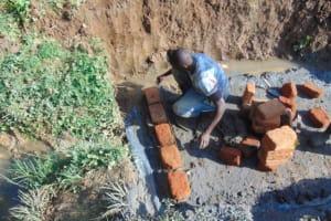 The Water Project: Shisasari Itumbu Community, Mathias Juma Spring -  Brick Setting