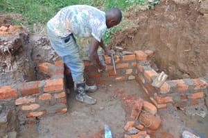 The Water Project: Shisasari Itumbu Community, Mathias Juma Spring -  Discharge Pipe Fitting