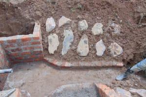 The Water Project: Shisasari Itumbu Community, Mathias Juma Spring -  Stone Pitching