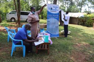 The Water Project: Shisasari Itumbu Community, Mathias Juma Spring -  Assembly Member Addresses Group