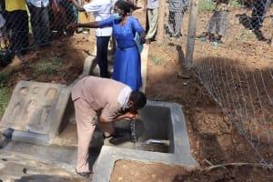 The Water Project: Shisasari Itumbu Community, Mathias Juma Spring -  County Assembly Member Drinking
