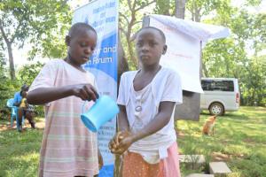 The Water Project: Shisasari Itumbu Community, Mathias Juma Spring -  Handwashing Demonstration