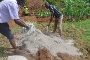 The Water Project: Shisasari Itumbu Community, Mathias Juma Spring -  Mixing Concrete