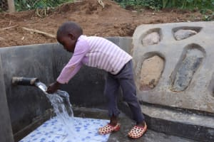 The Water Project: Shisasari Itumbu Community, Mathias Juma Spring -  Emanuel Washing His Hands
