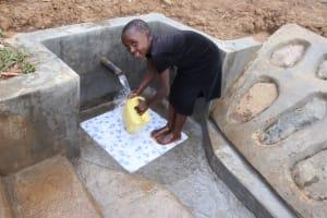 The Water Project: Shisasari Itumbu Community, Mathias Juma Spring -  Happily Fetching Water
