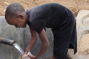 The Water Project: Shisasari Itumbu Community, Mathias Juma Spring -  Washing A Glass Before Quenching A Thirst