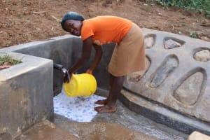 The Water Project: Shisasari Itumbu Community, Mathias Juma Spring -  Washing Her Bucket