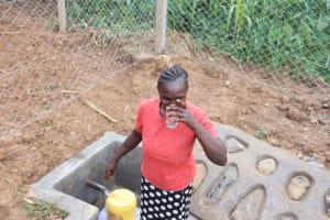The Water Project: Shisasari Itumbu Community, Mathias Juma Spring -  Water User Drinking Water
