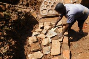 The Water Project: Bumira Community, Savai Spring -  Stone Pitching