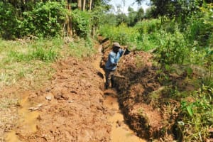 The Water Project: Bumira Community, Savai Spring -  Opening Up The Drainage Channel