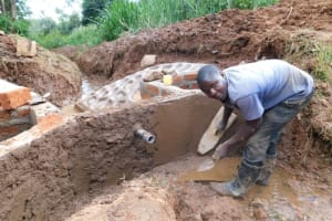 The Water Project: Bumira Community, Savai Spring -  Plastering The Inside Walls