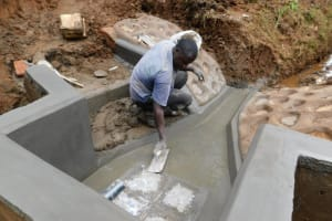 The Water Project: Bumira Community, Savai Spring -  Floor Plastering
